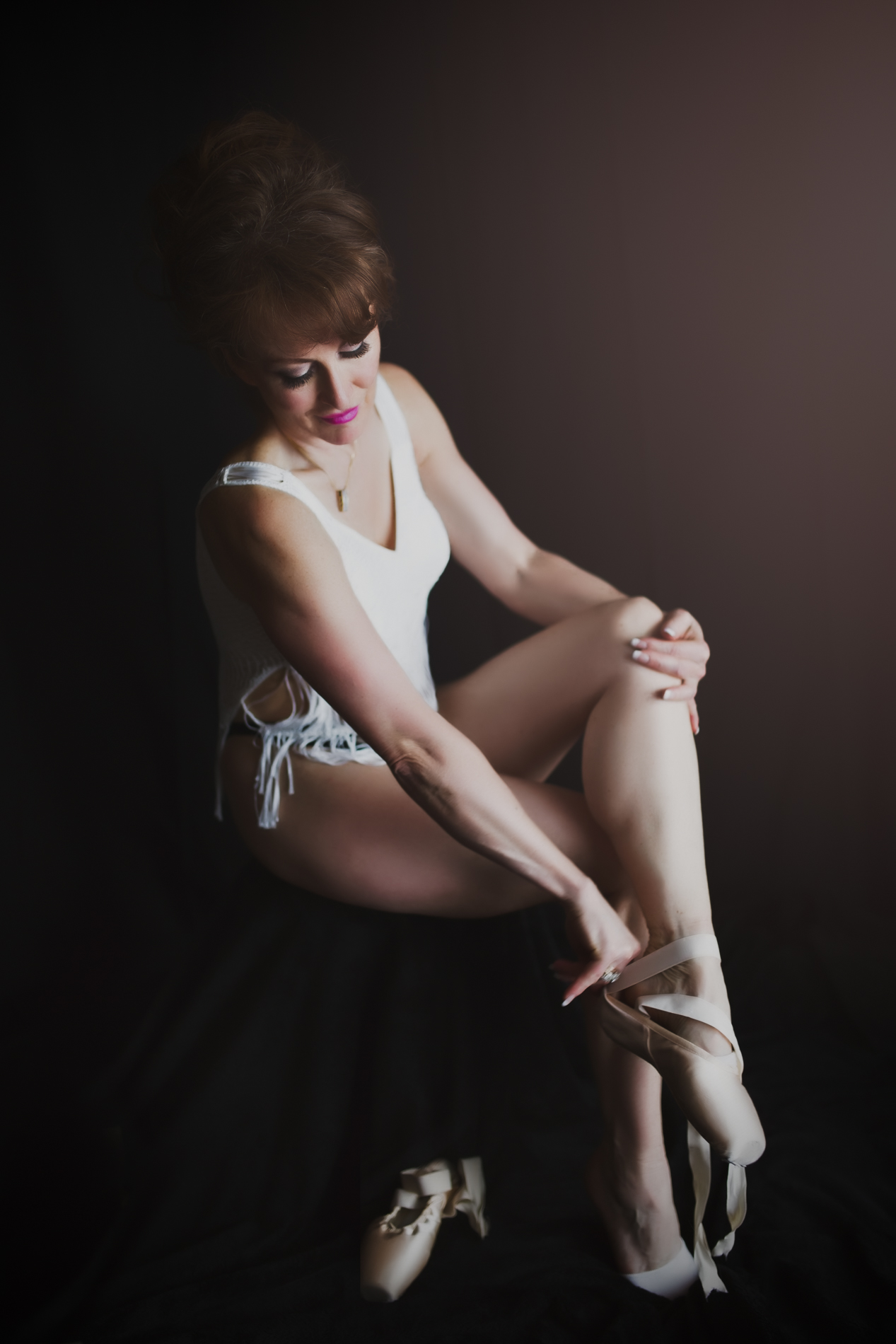 portrait of woman with ballet shoes