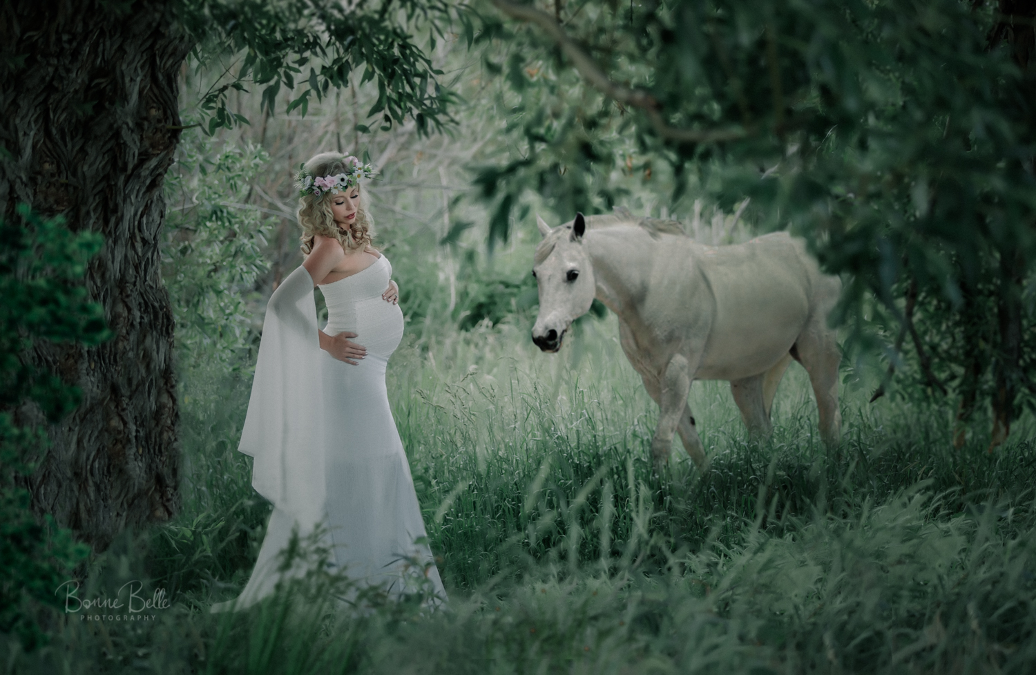Maternity woman with horse outdoors