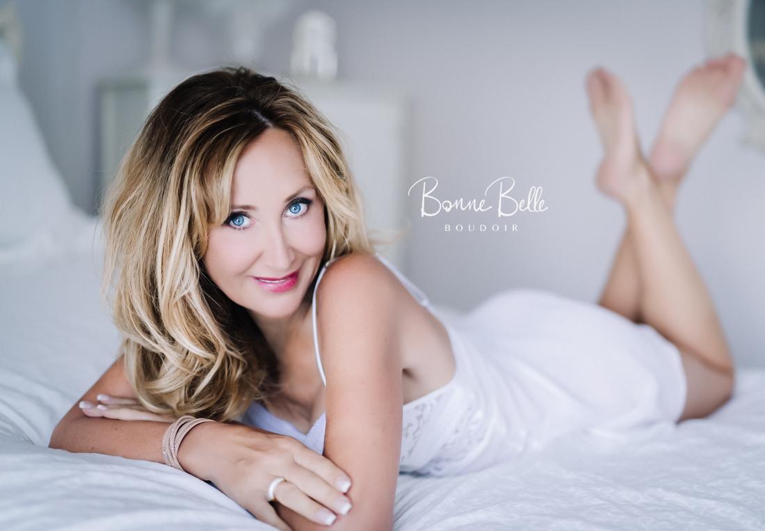 Woman in white boudoir shoot