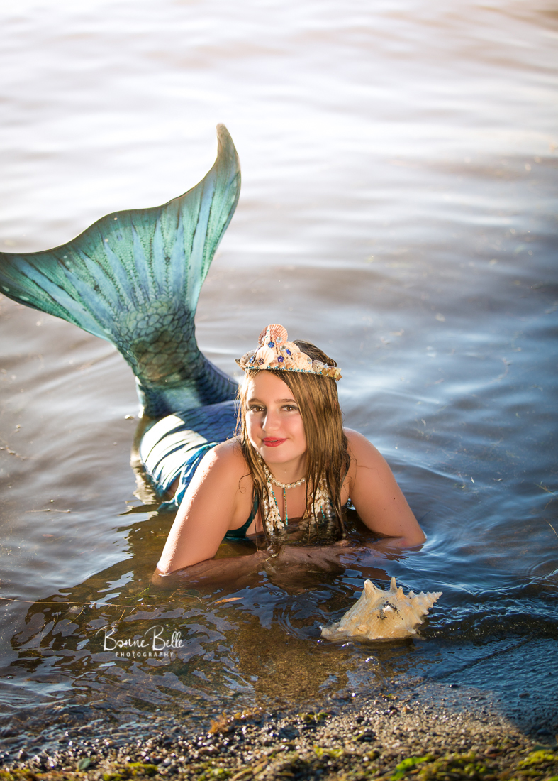 MERMAID RESTS IN SHALLOW WATER IN OKANAGAN LAKE, KELOWNA